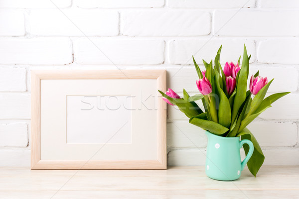 Wooden landscape frame mockup with pink tulips in jug Stock photo © TasiPas