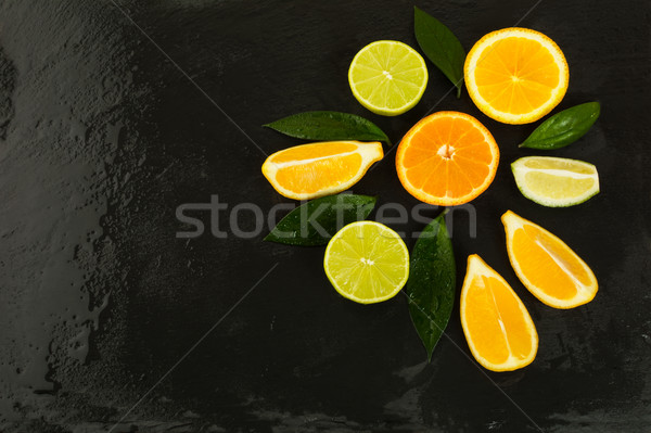 Detox concept with fresh fruits on black background Stock photo © TasiPas