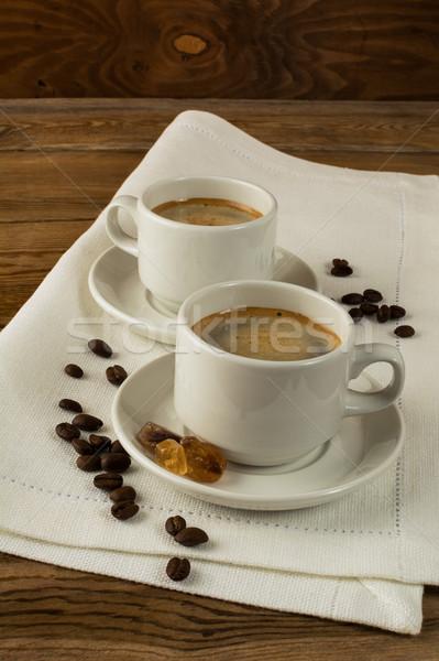Iki kahve fincanları esmer şeker peçete dikey Stok fotoğraf © TasiPas