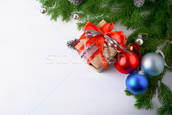 Christmas background with gift box and multicolored ornaments Stock photo © TasiPas
