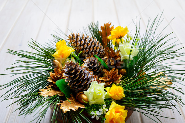 Christmas background with pine branches and golden decorated fir Stock photo © TasiPas