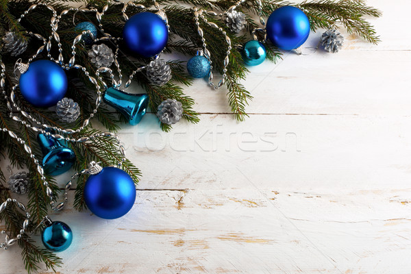 Christmas background with silver pinecone and blue ornaments Stock photo © TasiPas