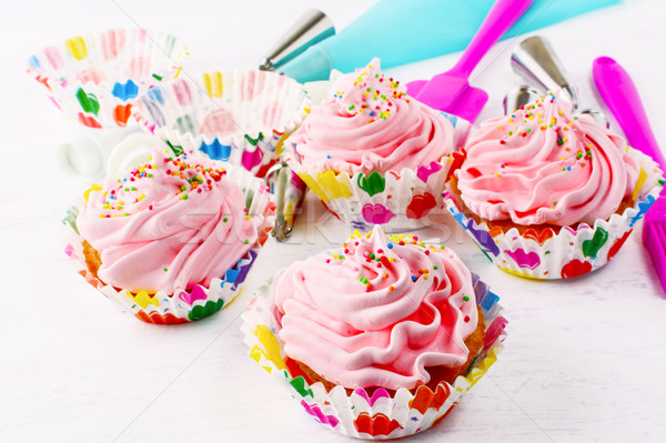 Homemade pink birthday cupcakes  and cookware Stock photo © TasiPas