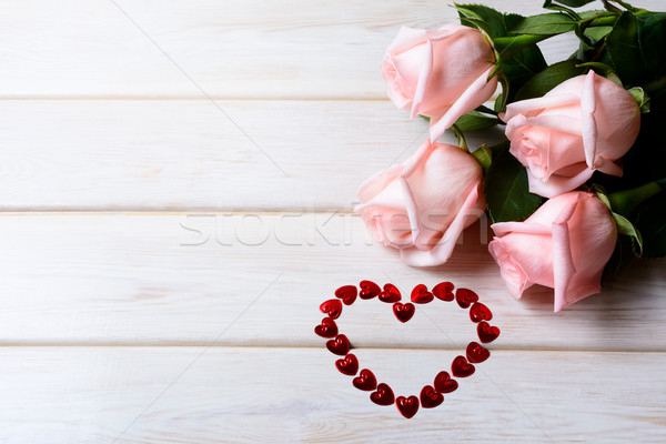 St. Valentine's Day background with pink roses and heart of red  Stock photo © TasiPas