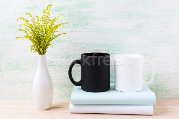 White and black mug mockup with ornamental green flowering grass Stock photo © TasiPas