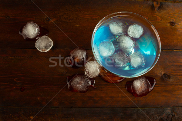 Blue Curacao liqueur with ice, top view Stock photo © TasiPas