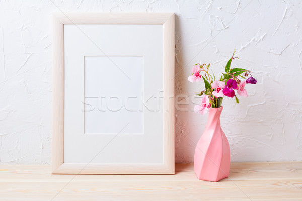 Wooden frame mockup with purple wildflowers in pink vase Stock photo © TasiPas