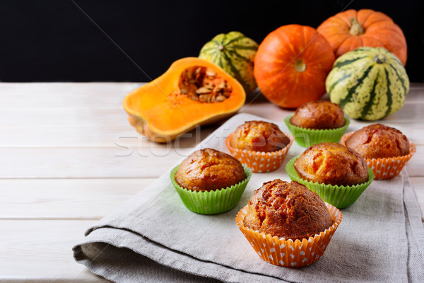 Butternut squash and honey muffins and ripe pumpkins Stock photo © TasiPas