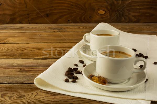 Cups of coffee on the linen napkin Stock photo © TasiPas