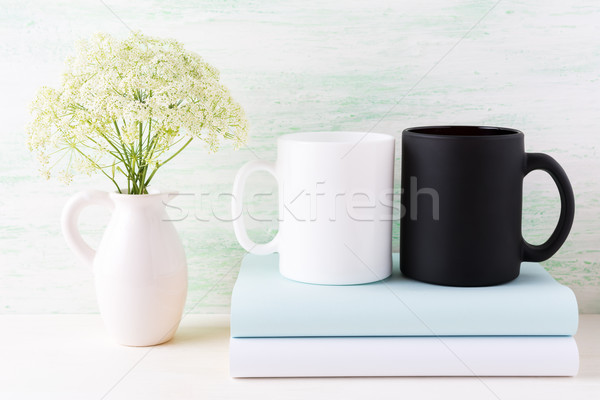 White and black mug mockup with books and white flowers Stock photo © TasiPas