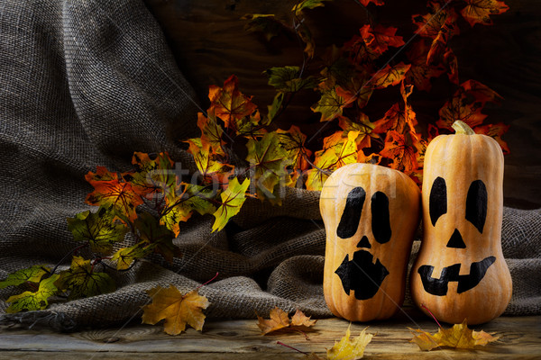 Halloween smiling butternut squash on dark rustic background Stock photo © TasiPas