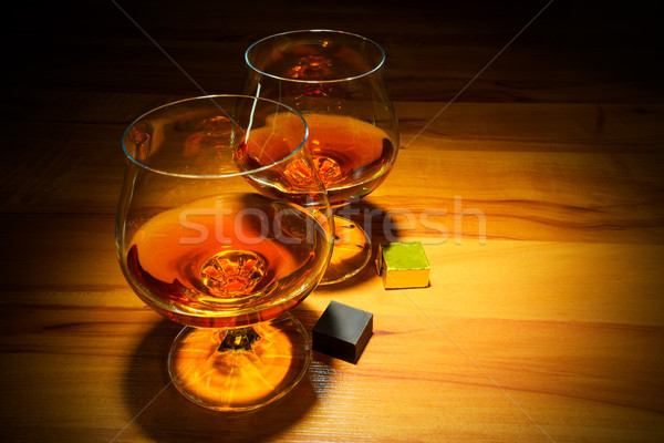 Two scotch glasses and chocolate bars  Stock photo © TasiPas