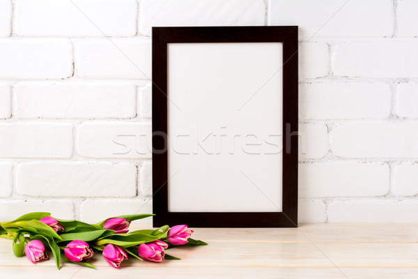 Black brown  frame mockup with magenta tulips bouquet Stock photo © TasiPas