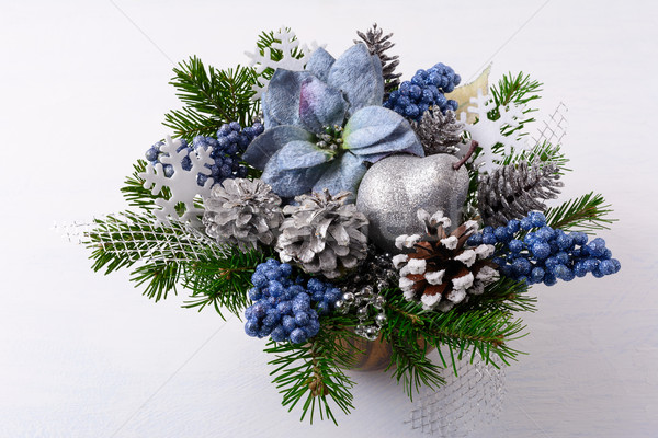 Christmas greenery with silver glitter decor and blue silk poins Stock photo © TasiPas