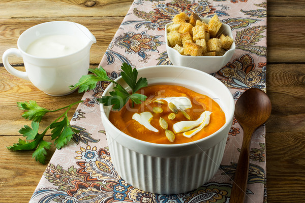 Autumnal pumpkin soup with cream Stock photo © TasiPas
