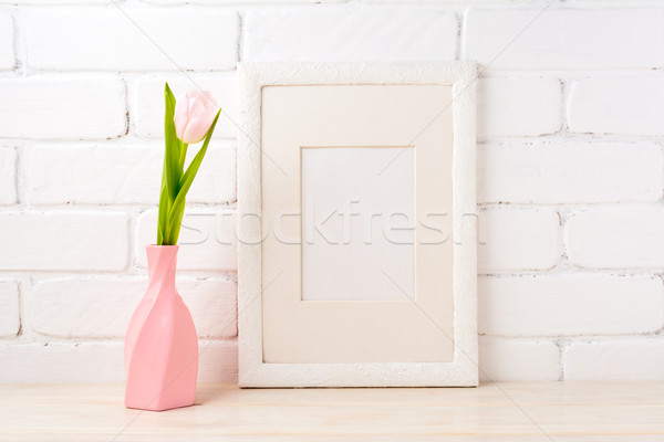 White frame mockup with pink tulip in swirled vase Stock photo © TasiPas