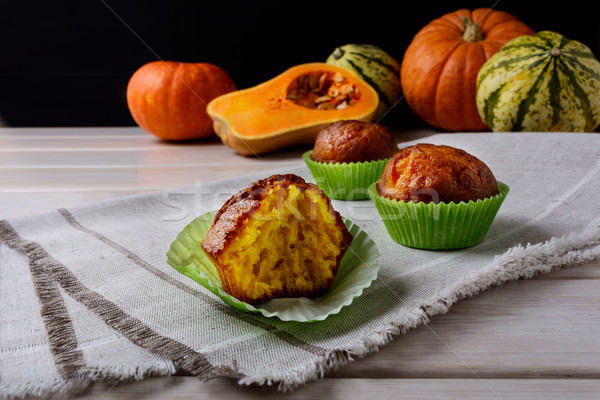 Spiced butternut squash muffins in the green wrappers Stock photo © TasiPas