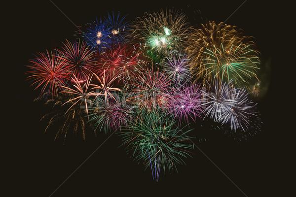 Beautiful celebration multicolored fireworks Stock photo © TasiPas