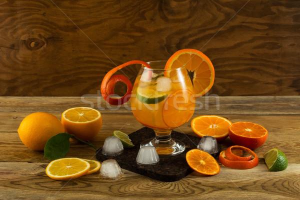Citrus lemonade on wooden background Stock photo © TasiPas