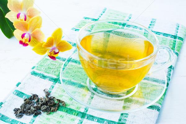 Cup of green tea on green checkered napkin Stock photo © TasiPas