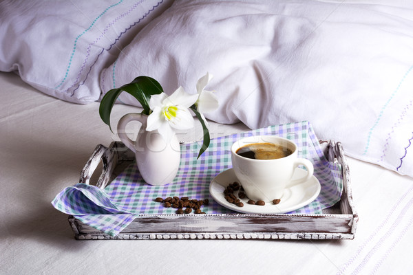 Cup of fresh coffee with white lily Stock photo © TasiPas