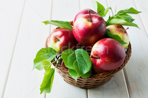Ripe red apples with green leaves  Stock photo © TasiPas