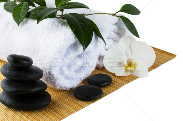 Spa concept with white orchid and spa stones isolated on white Stock photo © TasiPas