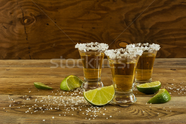 Dos oro tequila espacio de la copia tiro mexicano Foto stock © TasiPas