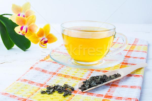 Кубок зеленый чай оранжевый салфетку желтый Сток-фото © TasiPas