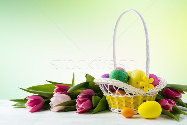 Elegante pintado ovos amarelo cesta Foto stock © TasiPas