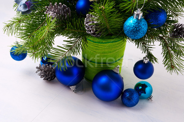 Christmas centerpiece with blue ornaments and fir branches in gr Stock photo © TasiPas