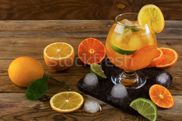 Tropical fruit cocktail with ice on wooden table  Stock photo © TasiPas