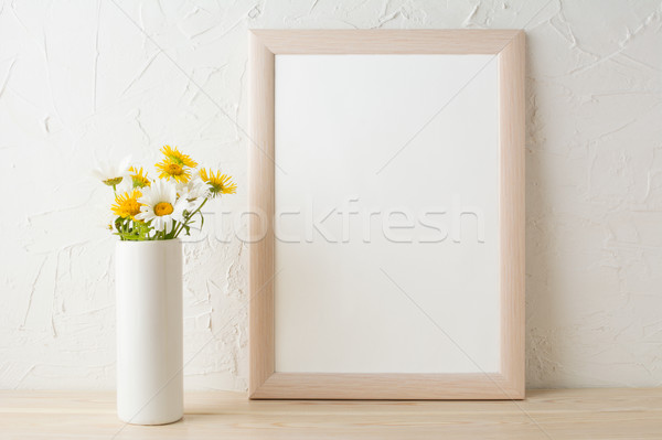 Frame mockup with white and yellow chamomiles in vase  Stock photo © TasiPas