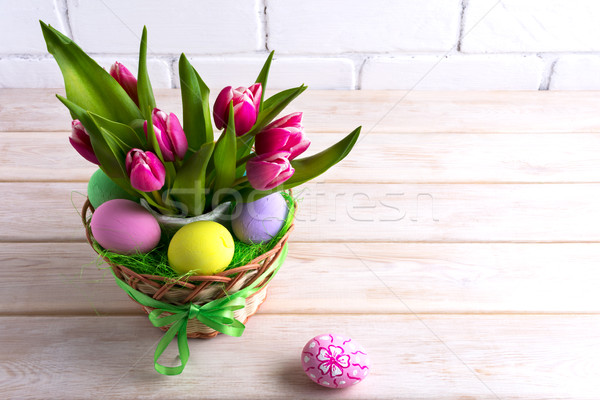 Easter table centerpiece with pastel color hand painted eggs Stock photo © TasiPas