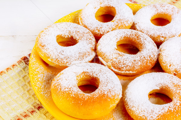 Stock photo: Sweet donuts served on yellow plate