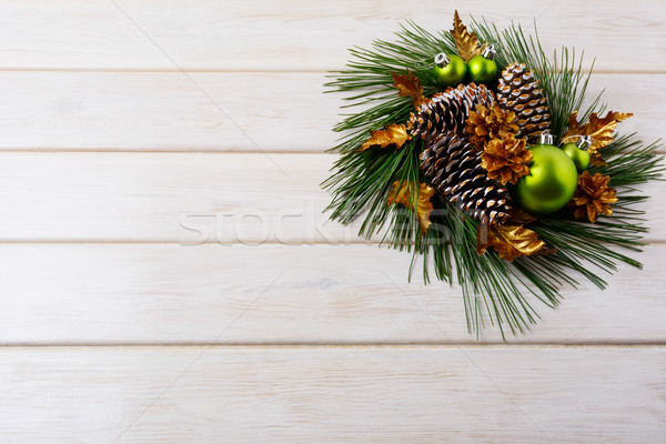 Christmas background with holiday golden cones decorated wreath Stock photo © TasiPas