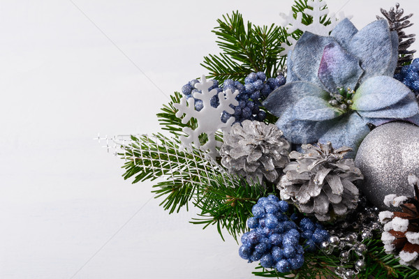 Christmas decoration with handmade snowflakes and blue silk poin Stock photo © TasiPas