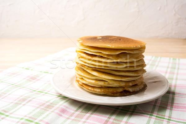 Stack of breakfast pancakes on the white plate Stock photo © TasiPas