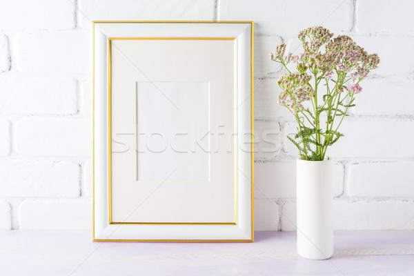 Altın dekore edilmiş çerçeve pembe çiçekler Stok fotoğraf © TasiPas