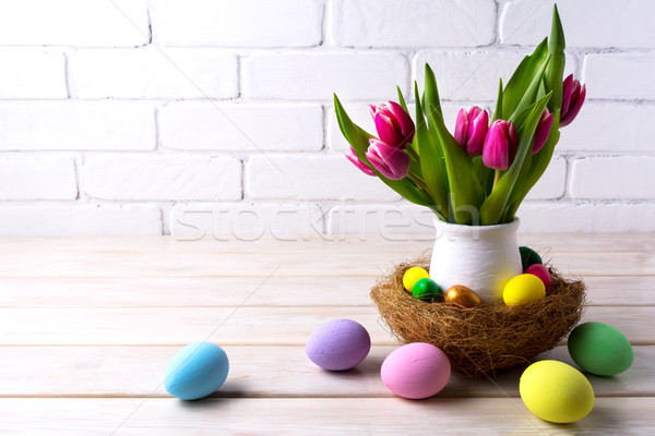 Easter table centerpiece with decorated eggs in nest Stock photo © TasiPas