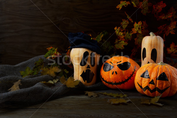 Halloween Stingy Jack pumpkins on rustic background, copy space Stock photo © TasiPas