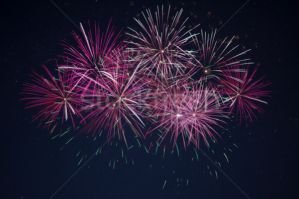 Sparkling maroon red pink celebration fireworks  Stock photo © TasiPas