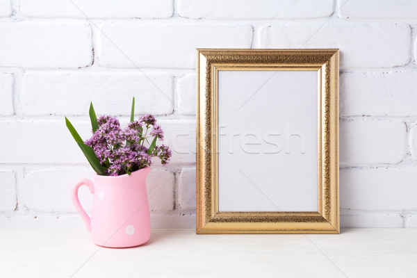 Golden  frame mockup with purple flowers in pink rustic pitcher  Stock photo © TasiPas
