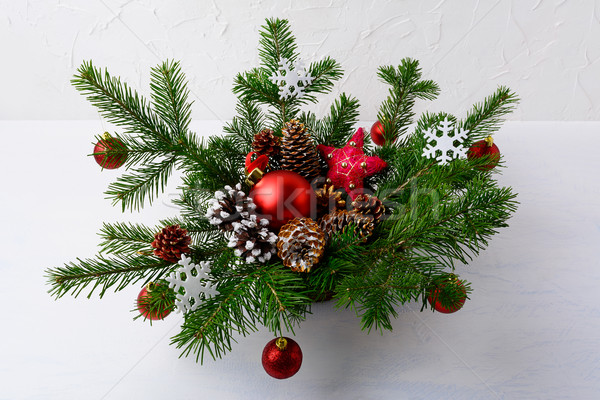 Christmas table centerpiece with red balls and rustic ornaments  Stock photo © TasiPas