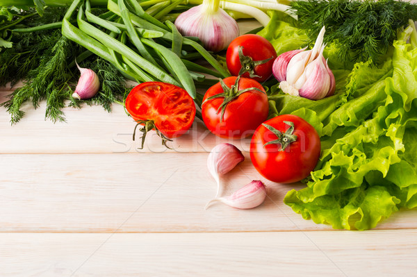 Fresh tomato and garlic, place for text Stock photo © TasiPas