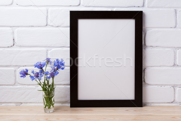 Black brown poster frame mockup with cornflower Stock photo © TasiPas