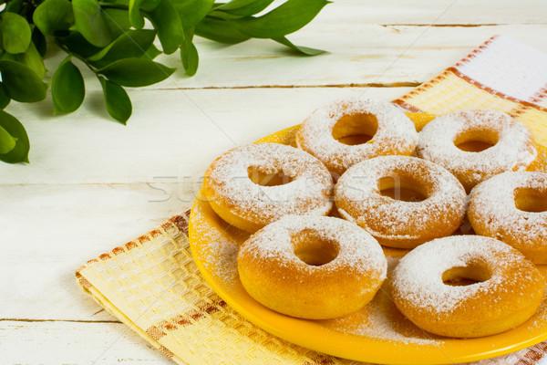 Hanukkah donuts on yellow plate Stock photo © TasiPas