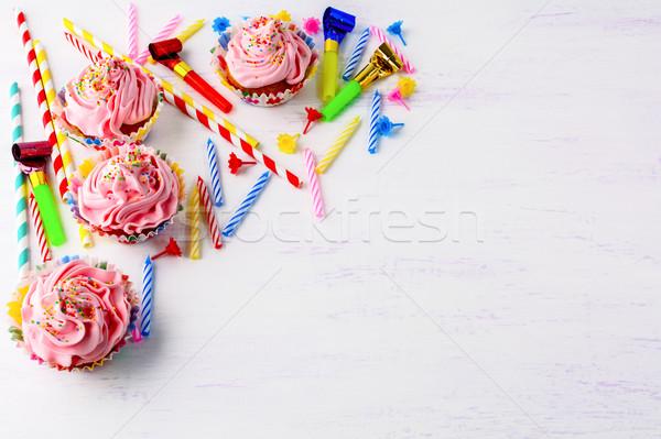 Birthday background with pink cupcakes  Stock photo © TasiPas
