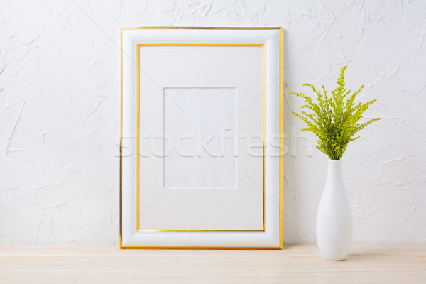 Gold decorated frame mockup with ornamental grass in exquisite v Stock photo © TasiPas