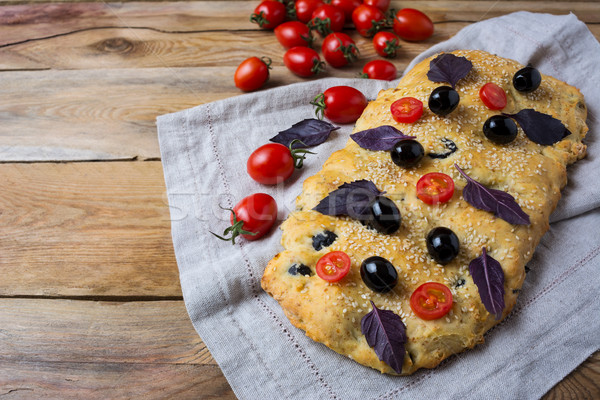 Italian bread focaccia with olive and cherry tomato, copy space Stock photo © TasiPas